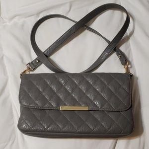 Damsel in defense purse